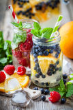 Cold summer drinks - blueberry with orange slices and raspb royalty free stock photo