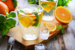 Cold summer soft drink with orange and basil Stock Photo