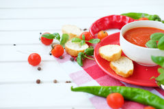 Cold summer tomato dish. Gaspacho soup with toast. Stock Photography