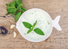 Cold summer yogurt and cucumber soup with fresh herbs Stock Image