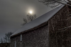 Cold Sun over Old Barn in January Royalty Free Stock Image