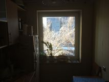 Cold sunny and snowy morning in Vilnius. Lithuania. View through the window stock image