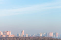 Cold sunrise over city in winter Royalty Free Stock Photo