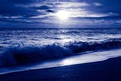 Cold sunrise over ocean. Atlantic coast. Florida, USA. Blue toned monochrome image Royalty Free Stock Photography
