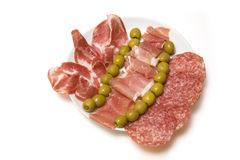 Cold Tapas meats on white Royalty Free Stock Photo