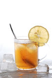 Cold tea. Lemon and ice cubes melted in water royalty free stock image