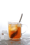 Cold tea. And ice cubes melted in water royalty free stock photo