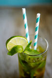 Cold  tea cocktail with ice and straw on board Stock Image