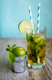 Cold tea cocktail with ice and straw on board Stock Photos