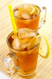 Cold tea with cubes of an ice and a lemon stock photography