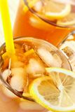 Cold tea with cubes of an ice and a lemon Stock Photo