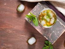 Cold tea with ice and mint leaves Royalty Free Stock Image