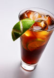 Cold tea with lime and ice Stock Images