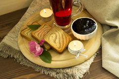 Cold tea with toasts and jam. The toasts served on a wooden support with jam and flower tea Stock Photo