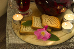 Cold tea with toasts and jam. The toasts served on a wooden support with jam and flower tea Royalty Free Stock Images
