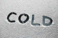 Cold text. The word cold is written in the snow Stock Images