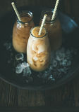 Cold Thai iced tea in bottles with milk, copy space Stock Photos