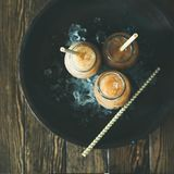 Cold Thai iced tea with milk, flatlay, square crop Royalty Free Stock Photos
