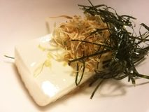 Cold tofu with seaweed and dry fish in a local restaurant, traditional Japanese food, appetizer dish, closed up Royalty Free Stock Photo