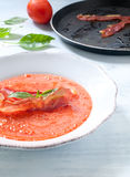 Cold tomato soup with crispy prosciutto from italy Royalty Free Stock Photos