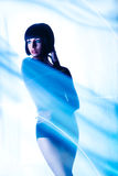 Cold tones photo of female behind cloth Stock Image