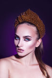 Cold tones portrait of beauty woman with wreath on head and cute Stock Photos
