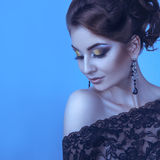 Cold tones portrait of elegance adult woman in studio Royalty Free Stock Photography