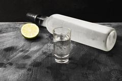 Cold vodka in shot glasses on a black background.  Stock Images