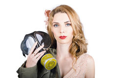Cold war pin-up woman with gasmask Stock Photography