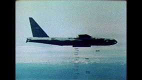 Cold War US - A B-52 bomber at bomb drop. Cold War Color. A US B-52 bomber at bombing drop stock video