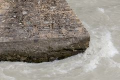 Cold water flowing around a concrete structure Royalty Free Stock Photos
