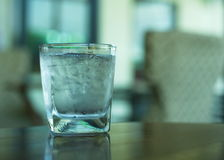 Cold water in clear glass with ice Royalty Free Stock Image