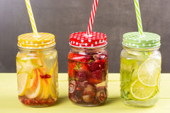 Cold water with fruits Stock Photos