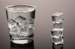 Cold water with ice. Cold water. Sparkling. With ice. Stack. Black and white stock photos