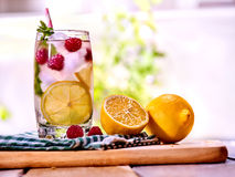 Cold water with lemon and mint leaf. Raspberries lemonade. Cold water with lemon and mint leaf. Fresh raspberries lemonade with lemon slice and ice cubes. Non Stock Photos