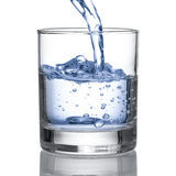 Cold water pour water to glass on white Stock Photos