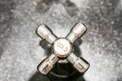 Cold water tap in the bathroom. Faucet for cold water in the bathroom Stock Photo