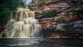 """""""Poço do diabo"""" waterfall, Mucugezinho river, Lençóis - Bahia, Brazil. Cascate shot a slow shutter speed. River with dark waters and there are stock photos"""