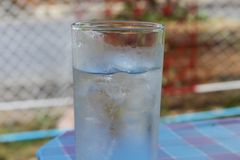 Cold Water on Wood Table. glass of Cool fresh drink with ice stock images