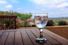 Cold water on wooden table with nature background Stock Photography