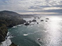 Aerial of Pacific Ocean and Coastline in California. The cold waters of the Pacific Ocean wash against the beautiful coastline of Mendocino in northern Royalty Free Stock Photo