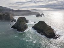 Aerial of Rugged Mendocino Coastline in Northern California. The cold waters of the Pacific Ocean wash against the beautiful coastline of Mendocino in northern stock photos