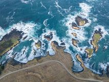 Aerial of Beautiful Mendocino Coastline in California. The cold waters of the Pacific Ocean wash against the rocky coastline of Sonoma in northern California stock photos