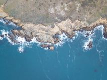Aerial of Rugged Sonoma Coastline in California. The cold waters of the Pacific Ocean wash against the rocky coastline of Sonoma in northern California. This royalty free stock photos
