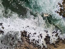 Aerial of Beautiful Northern California Coastline. The cold waters of the Pacific Ocean wash against the rocky Northern California coastline in Monterey. This royalty free stock photography