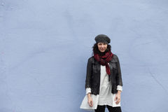 Cold-weather clothing and serenity blue wall Royalty Free Stock Images