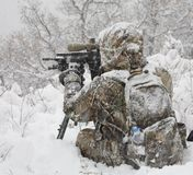 Cold weather hunter. Hunter in camouflage that is behind a rifle in a blizzard Stock Photography