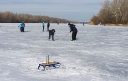 At cold weather people use frozen river Dnepr for to go in for skating Royalty Free Stock Photo