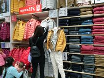 Shenzhen, China: People buy winter clothes in Uniqlo in cold weather stock images