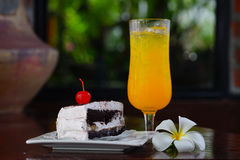Cold wet orange juice and bakery. Cold wet orange juice on glass and bakery Royalty Free Stock Photos